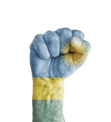 Flag of Rwanda painted on human fist like victory symbol