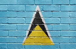 Flag of Saint Lucia painted onto a grunge brick wall
