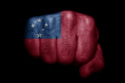 Flag of Samoa painted on strong fist on black background