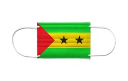 Flag of Sao Tome and Principe on a disposable surgical mask. White background isolated