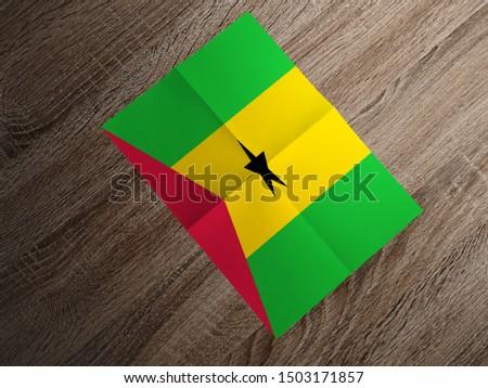 Flag of Sao Tome and Principe on paper. Sao Tome and Principe Flag on wooden table. #1503171857