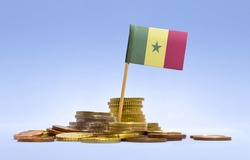 Flag of Senegal in a mixed stack of european coins and a blue background.(series)