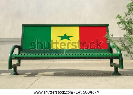 Flag of Senegal on bench. Senegal Flag on bench advertisement #1496084879