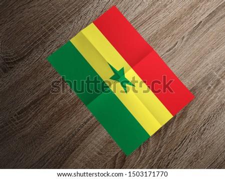 Flag of Senegal on paper. Senegal Flag on wooden table. #1503171770