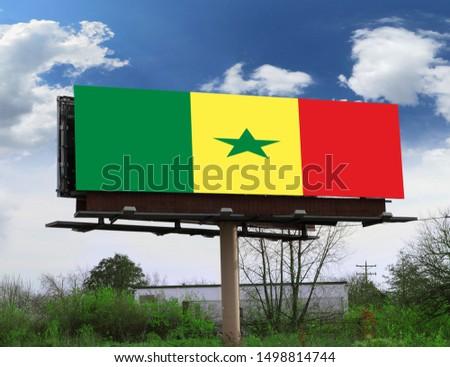 Flag of Senegal on wooden board. Paper Flag of Senegal on wooden table. #1498814744
