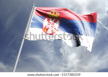 Flag of Serbia in the sky. National Flag of Serbia on flag pole for Independence day. #1557380339