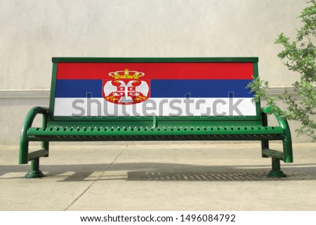 Flag of Serbia on bench. Serbia Flag on bench advertisement #1496084792