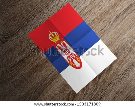 Flag of Serbia on paper. Serbia Flag on wooden table. #1503171809