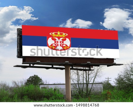 Flag of Serbia on wooden board. Paper Flag of Serbia on wooden table. #1498814768