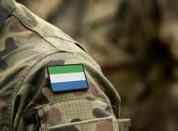 Flag of Sierra Leone on military uniform. collage.