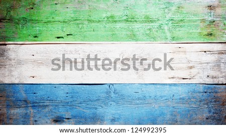 Flag of Sierra Leone painted on grungy wood plank background