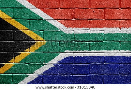 Flag of South Africa painted onto a grunge brick wall