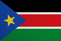 Flag of South Sudan. Brick wall texture of the flag of South Sudan.