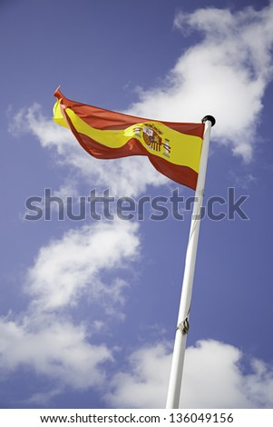 Flag of Spain, detail of fabric flag fluttering in the wind, patriotic
