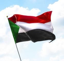 Flag of Sudan Raised Up in The Sky