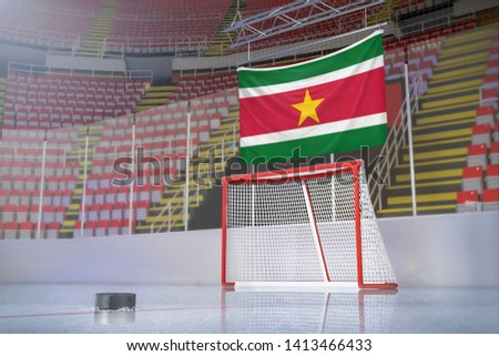 Flag of Suriname in hockey arena with puck and net #1413466433