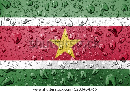Flag of Suriname on a metallic background. The Suriname flag with rain droplets #1283454766