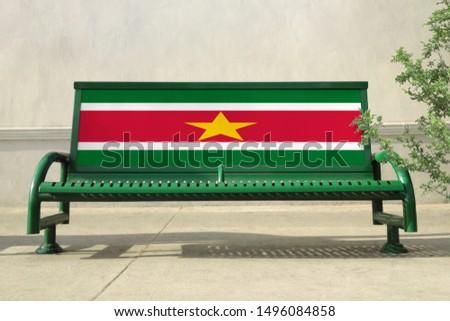 Flag of Suriname on bench. Suriname Flag on bench advertisement #1496084858