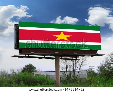 Flag of Suriname on wooden board. Paper Flag of Suriname on wooden table. #1498814732