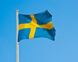 Flag of Sweden against blue sky