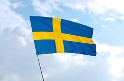 Flag of Sweden in front of blue sky