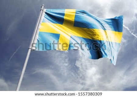 Flag of Sweden in the sky. National Flag of Sweden on flag pole for Independence day. #1557380309