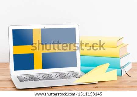 Flag of Sweden on Laptop. Sweden Flag on Screen. #1511158145