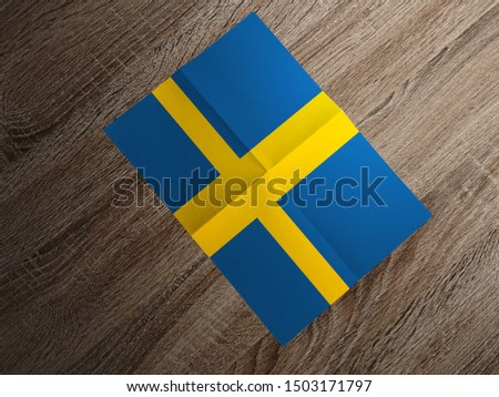 Flag of Sweden on paper. Sweden Flag on wooden table.