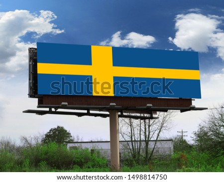 Flag of Sweden on wooden board. Paper Flag of Sweden on wooden table.