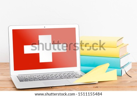 Flag of Switzerland on Laptop. Switzerland Flag on Screen. #1511155484