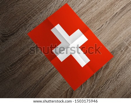 Flag of Switzerland on paper. Switzerland Flag on wooden table. #1503175946