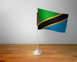 Flag of Tanzania Table. Tanzania Desk Flag on Wooden Table.