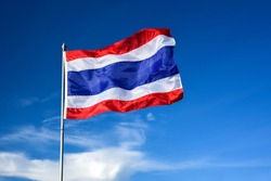 Flag of Thailand. Image of waving Thai flag of Thailand with blue sky background. Flags waving in the wind.