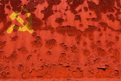 Flag of the Communist party, at the faded and  rusty background. Concept photo