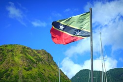 Flag of the Federation of St Kitts and Nevis floating on a mast