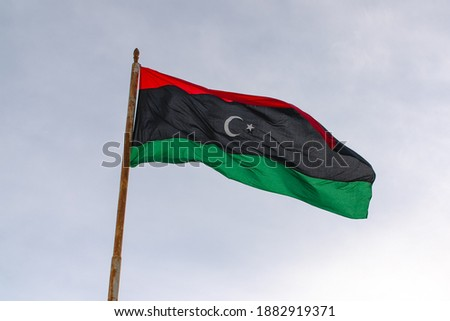 Flag of the state of Libya The flag of Libya was originally introduced in 1951, following the creation of the Kingdom of Libya. Stockfoto ©