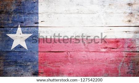 Flag of the State of Texas painted on grungy wooden background
