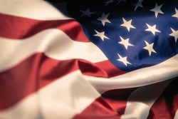 Flag of the United States of America closeup. Symbol of freedom and democracy. Independence day. Easy toning photo.