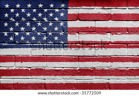 Flag of the United States of America painted onto a grunge brick wall - stock photo
