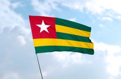 Flag of Togo in front of blue sky