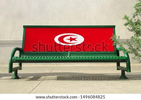 Flag of Tunisia on bench. Tunisia Flag on bench advertisement #1496084825