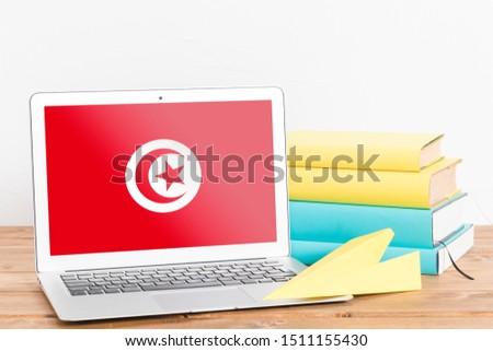 Flag of Tunisia on Laptop. Tunisia Flag on Screen. #1511155430