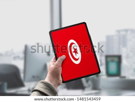 Flag of Tunisia on Tablet/Ipad. Tunisia Flag. #1481543459