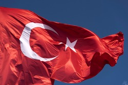 Flag of Turkey. National flag consisting of a red field (background) with a central white star and crescent.