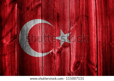Flag of Turkey painted on grungy wood plank background