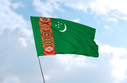 Flag of Turkmenistan in front of blue sky