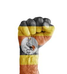 Flag of Uganda painted on human fist like victory symbol