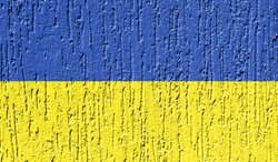 Flag of Ukraine close up painted on a cracked wall