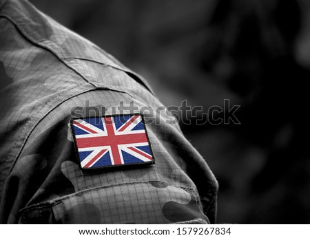 Photo of  Flag of United Kingdom on military uniform. UK Army. British Armed Forces, soldiers. Collage.