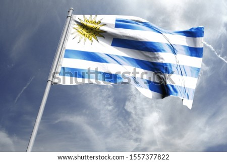 Flag of Uruguay in the sky. National Flag of Uruguay on flag pole for Independence day. #1557377822